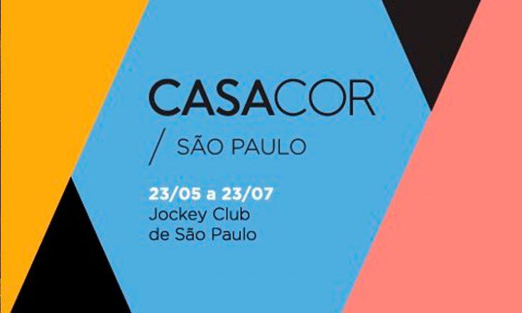 Arte da Casacor São Paulo, com várias formas geométricas, nas cores amarelo queimado, preto, azul, preto novamente e goiaba. No centro, as palavras Casacor São Paulo 23/05 a 23/07 Jockey Club de São Paulo